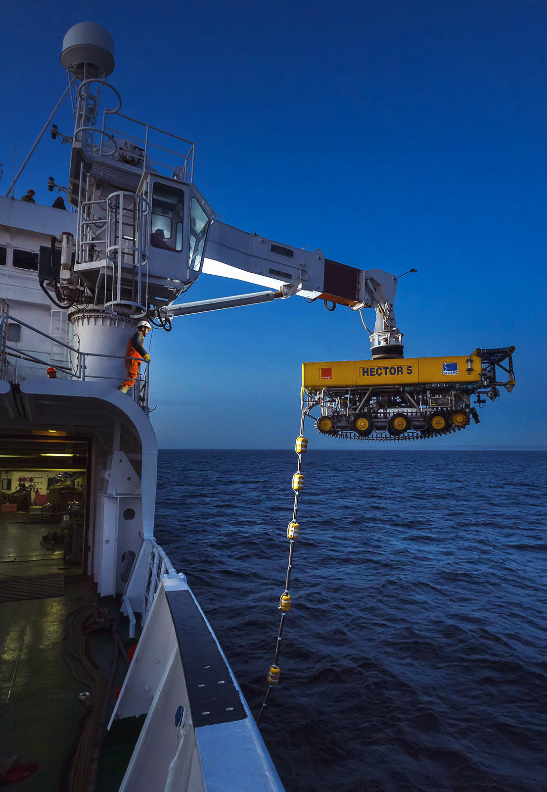 ROV being launched by davit from cable ship