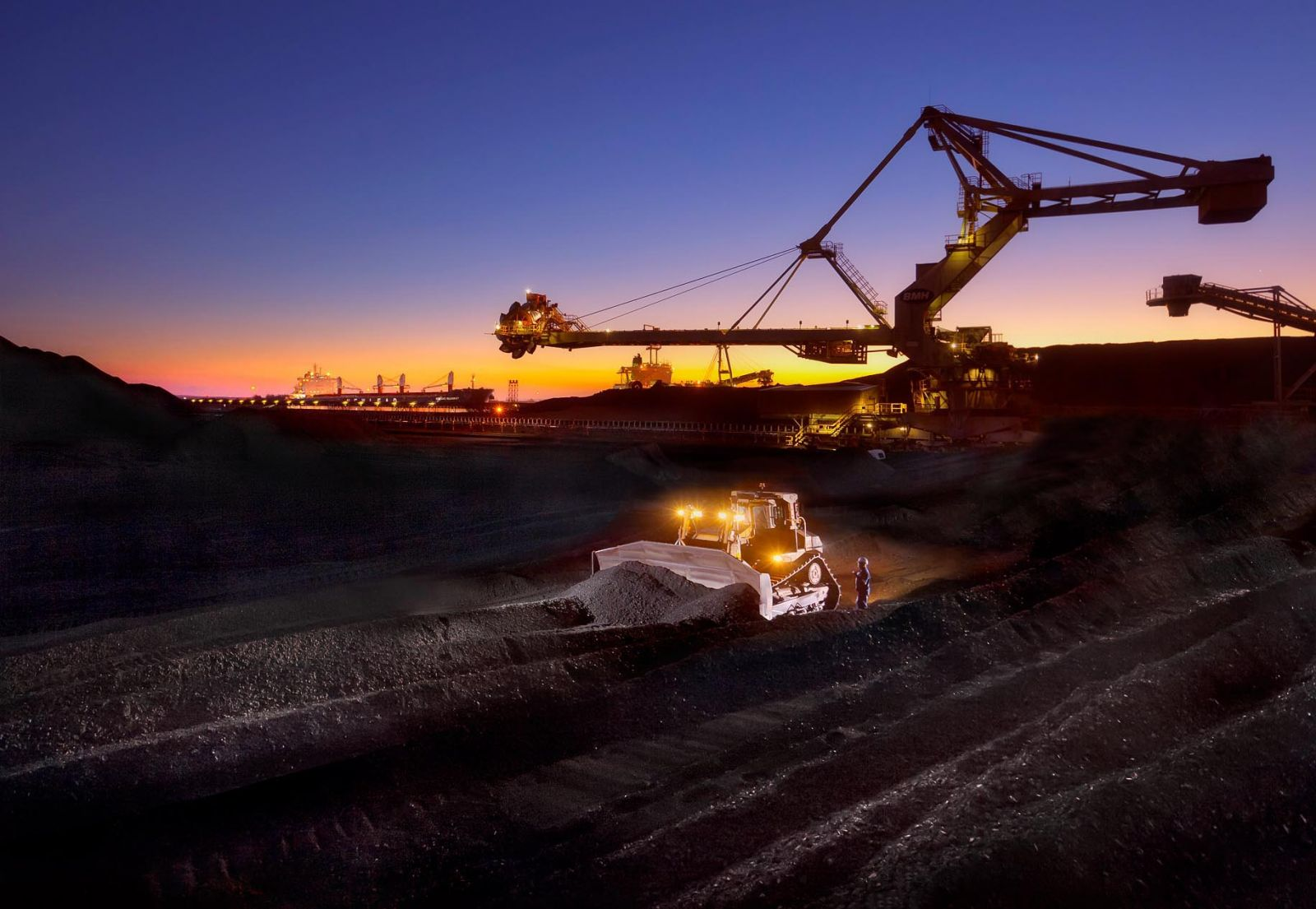 Loader handles coal stockpiles at export facilities at harbour