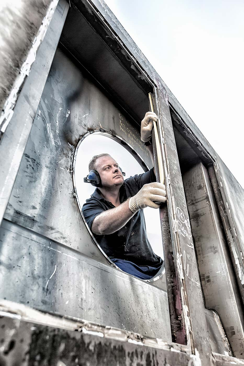 Engineer working on construction of rolling stock for railways - industrial photography portfolio